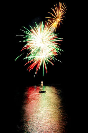 fireworks on the lake with reflections on water photo