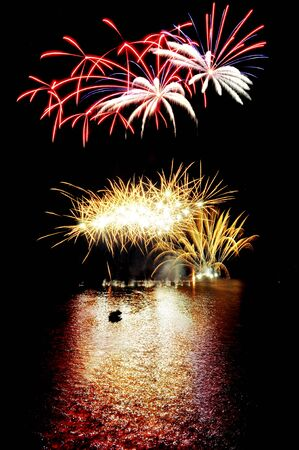fireworks on the lake with reflections on water Stock Photo - 14970300