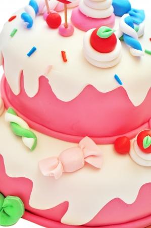 pasteles de cumpleaños: Detalle de una tarta de cumpleaños de color rosa para niña Foto de archivo