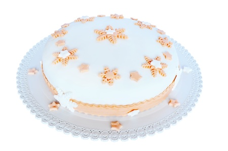 sugar paste: Sugar paste, white cake with pink decoration in the shape of stars and snowflakes. Isolated on white background