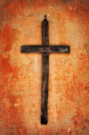 exorcism: old wooden cross on a grunge crumbling wall