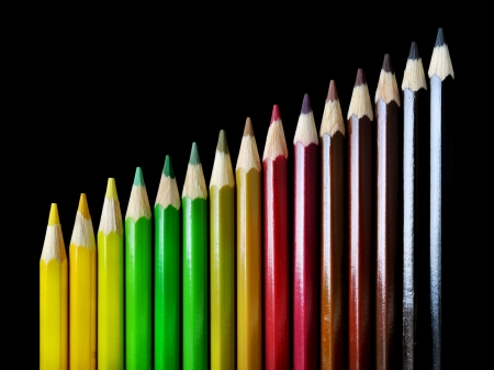 chromatic color: Color Pencil Crayons with autumn colors ordered in chromatic scale, on black background Stock Photo