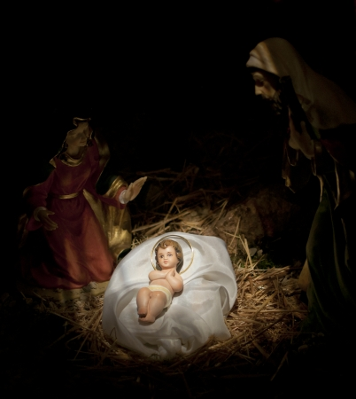 the christ: nativity scene on black background, jesus birth, Mary and Josef Stock Photo