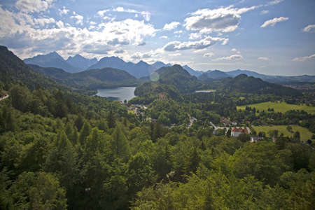 Looking out over the Alps and a lake from Neuschwanstein castle in Bavaria Germany