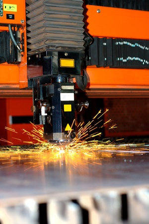 cutting tool: Indsutrial laser with sparks flying around with copy space