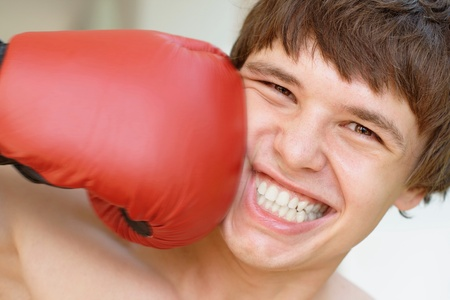 Smiling boxer gets a punch photo