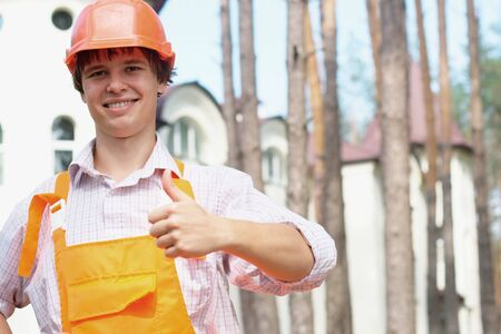Photo of a manual worker with thumb up outdoors with copy space photo