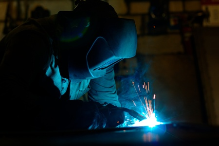 metalwork: Photo of a welding process wtih sparks flying around (with copy space)