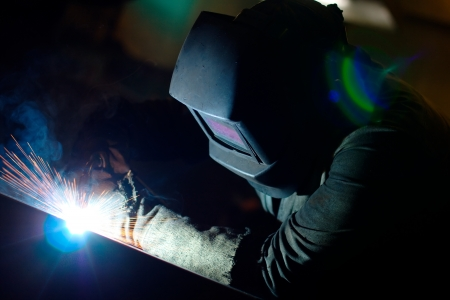 Photo of a welding process wtih sparks flying around (with copy space) Stock Photo - 10135839
