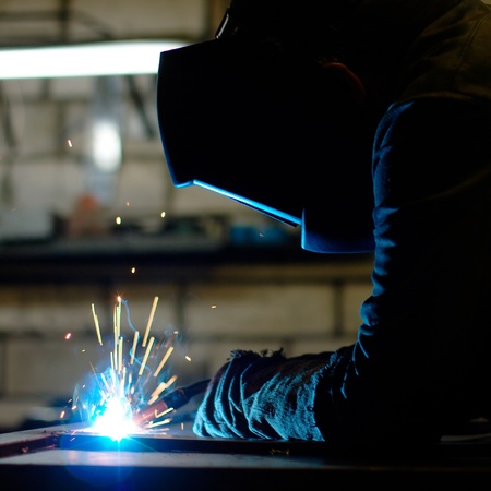 Photo of a welding process wtih sparks flying around (with copy space) Stock Photo - 10135529