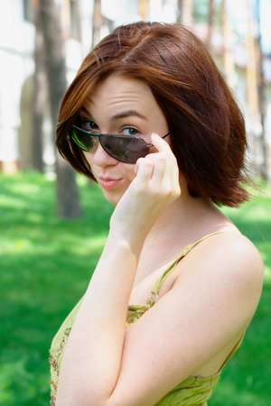 Girl with sunglasses at the park Stock Photo - 10335607
