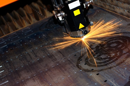 Industrial laser with sparks flyiing around (with copy space) Stock Photo - 10335680