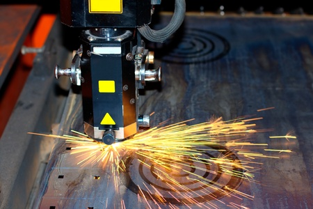 Industrial laser with sparks flyiing around (with copy space) photo