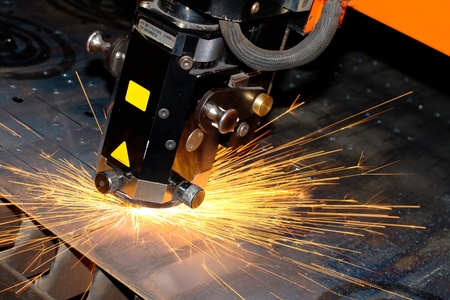 Industrial laser with sparks flyiing around (with copy space) Stock Photo - 10335679