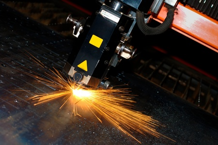 Industrial laser with sparks flyiing around (with copy space) Stock Photo - 10335664