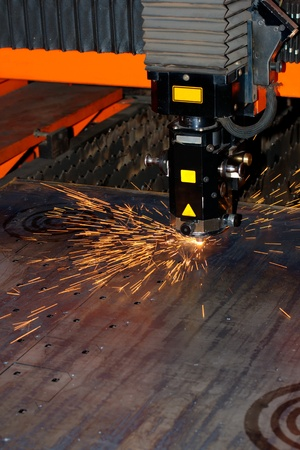 Industrial laser with sparks flyiing around (with copy space) Stock Photo - 10335671