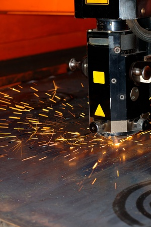 Industrial laser with sparks flyiing around (with copy space) Stock Photo - 10335656