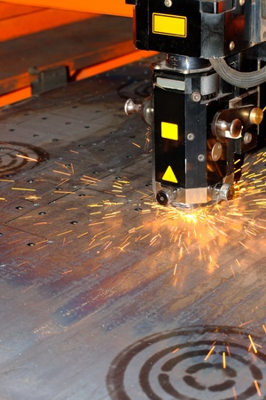 Industrial laser with sparks flyiing around (with copy space) Stock Photo - 10335678