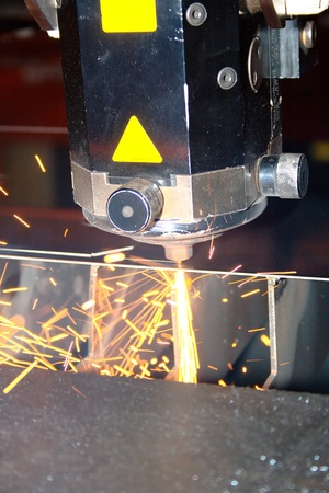 Industrial laser with sparks flyiing around (with copy space) Stock Photo - 10335666