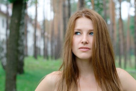 sexuality: Close-up portrait of young girl at the park with copy space