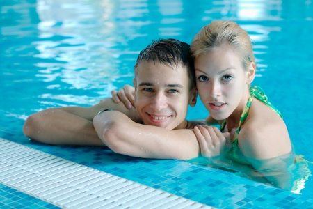 Happy young couple at the swimming pool photo