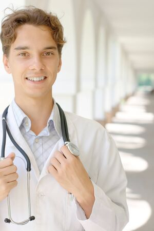 Portrait of a smiling young doctor with copy space Stock Photo - 10356617