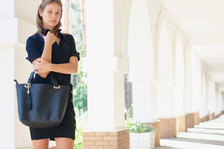 handbag: Close-up portrait of a young women with handbag Stock Photo