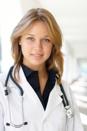 stethoscopes: Smiling young female doctor outdoors Stock Photo