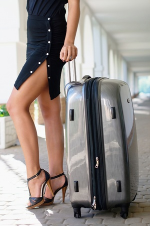 sexy business woman: Sexy women with luggage outdoors
