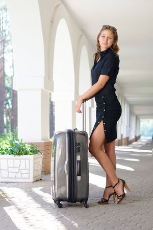 Young women with luggage outdoors Stock Photo - 10461294
