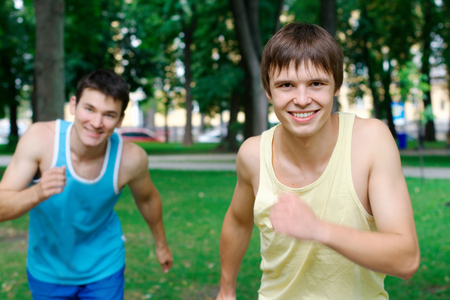 blood sport: Two young man jogging at the park