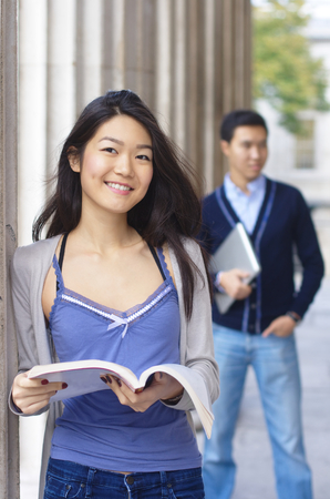 baccalaureate: Happy university students with columns at the background