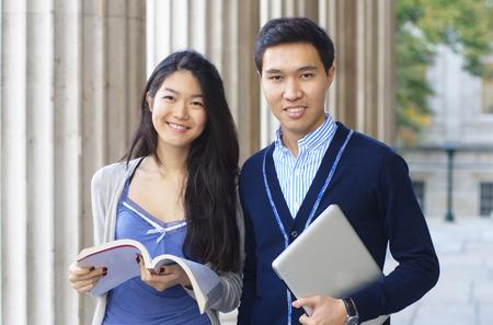 Happy university students with columns  photo