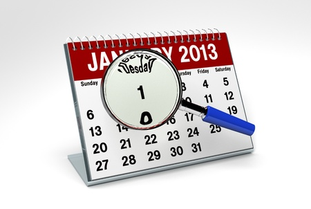 January 2013 Calendar isolated on white background with magnifying glass photo