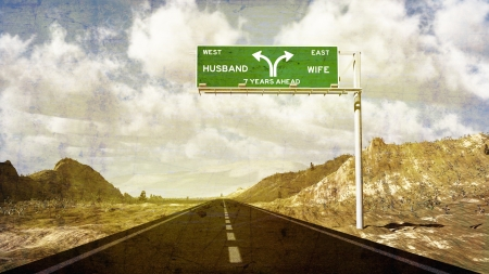 Road sign showing divorce ahead and splitting up  Seven year itch  Фото со стока