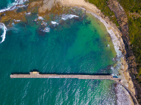 Aerial view of the historic coal loader jettry at Catherine Hill Bay, New South Wales, Australia