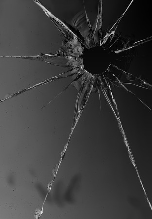Shattered and broken glass on a dark background. Abstract illustration.