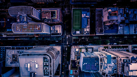 City streets at dusk as seen from above. Aerial photograph. Urban scene. 版權商用圖片 - 118434804