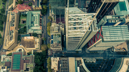 Top down aerial view of skyscrapers in a downtown city district. Metropolis 免版税图像