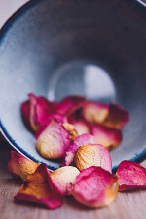 Dried rose petals: for tea, alternative medicine, pot-pourri in ceramic rustic bowl.