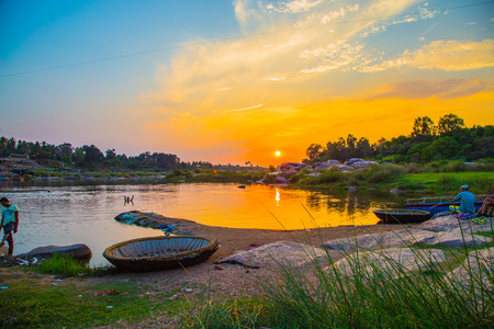 Sunset on Indian river, Hampi, India Stock Photo
