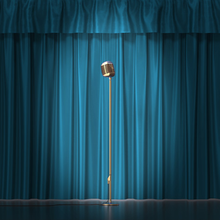 radio beams: Retro gold microphone on blue cloth background.