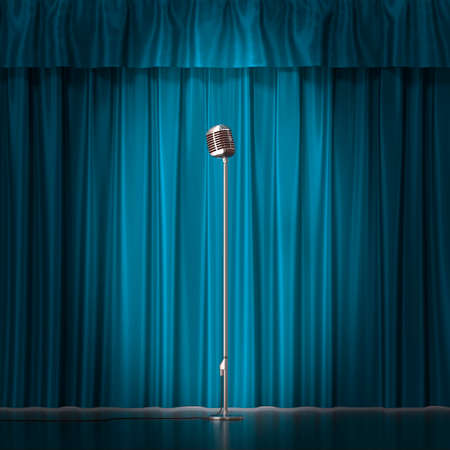 radio beams: Retro silver microphone on blue cloth background.
