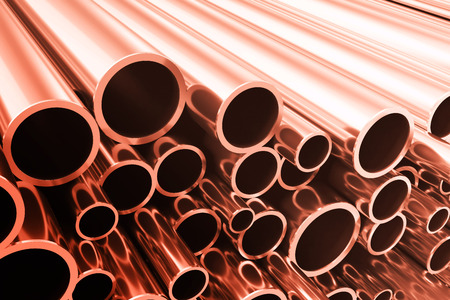 steel pipes: Industry business production and heavy metallurgical industrial products, many shiny steel pipes, industrial background, manufacturing business production concept, copper pipes with selective focus effect, 3D illustration Stock Photo