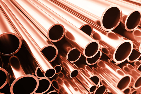raw materials: Industry business production and heavy metallurgical industrial products, many shiny steel pipes, industrial background, manufacturing business production concept, copper pipes with selective focus effect, 3D illustration Stock Photo