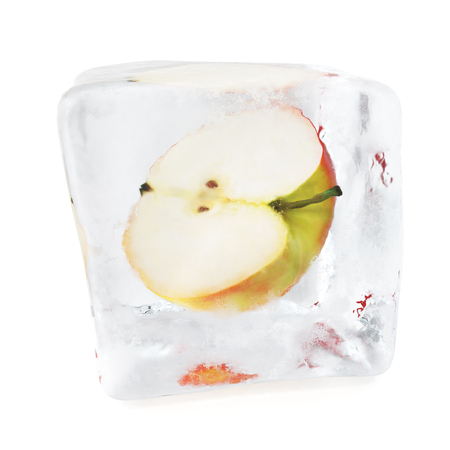 refrigerate: Slice Apple frozen in ice cube, ice cube in front, single ice cube isolated on white background. 3d rendering