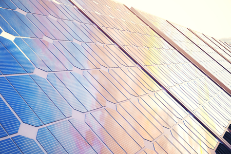 3D illustration solar power generation technology. Alternative energy. Solar battery panel modules with scenic sunset with blue sky with sun light. Stock Photo
