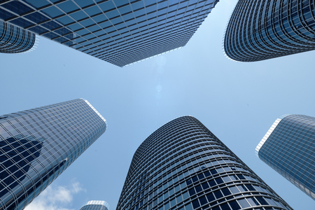 3D illustration Low angle view of skyscrapers. Skyscrapers at in day looking up perspective. Bottom view of skyscrapers in business district in daylight. Business concept of success
