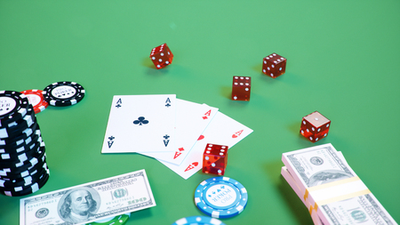 3D illustration casino game. Chips, playing cards for poker. Poker chips, red dice and money on green table. Online casino concept