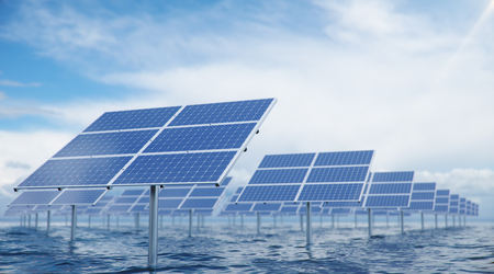 3D illustration solar panels in the sea or ocean. Alternative energy. Concept of renewable energy. Ecological, clean energy. Solar panels, photovoltaic with reflection beautiful blue sky.